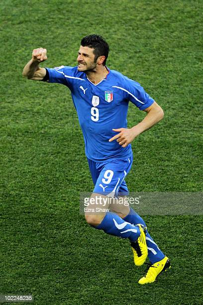 Vincenzo Iaquinta of Italy celebrates scoring the first goal for his team from the penalty spot during the 2010 FIFA World Cup South Africa Group F...