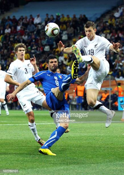 Vincenzo Iaquinta of Italy is tackled by Tommy Smith of New Zealand during the 2010 FIFA World Cup South Africa Group F match between Italy and New...
