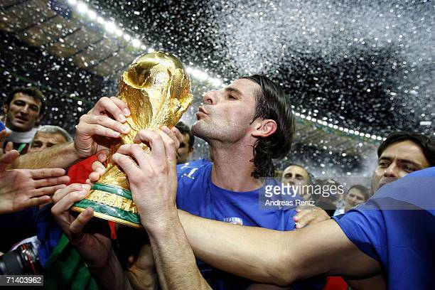 Vincenzo Iaquinta of Italy kisses the world cup trophy following his team's victory during the FIFA World Cup Germany 2006 Final match between Italy...