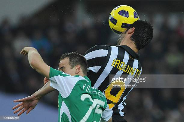 Vincenzo Iaquinta of Juventus FC clashes with Steve Von Bergen of AC Cesena during the Serie A match between Juventus FC and AC Cesena at Olimpico...