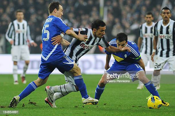 Vincenzo Iaquinta of Juventus FC is challenged by Steve Von Bergen of AC Cesena during the Serie A match between Juventus FC and AC Cesena at...