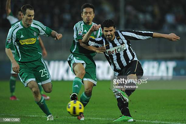 Vincenzo Iaquinta of Juventus FC is challenged by Yuto Nagatomo of AC Cesena during the Serie A match between Juventus FC and AC Cesena at Olimpico...