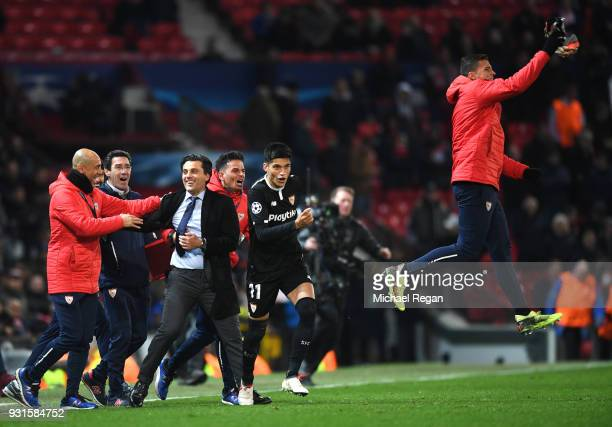 Vincenzo Montella manager of Sevilla and the Sevilla team bench celebrate victory after the UEFA Champions League Round of 16 Second Leg match...