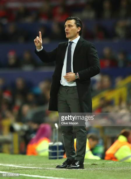 Vincenzo Montella manager of Sevilla signals during the UEFA Champions League Round of 16 Second Leg match between Manchester United and Sevilla FC...