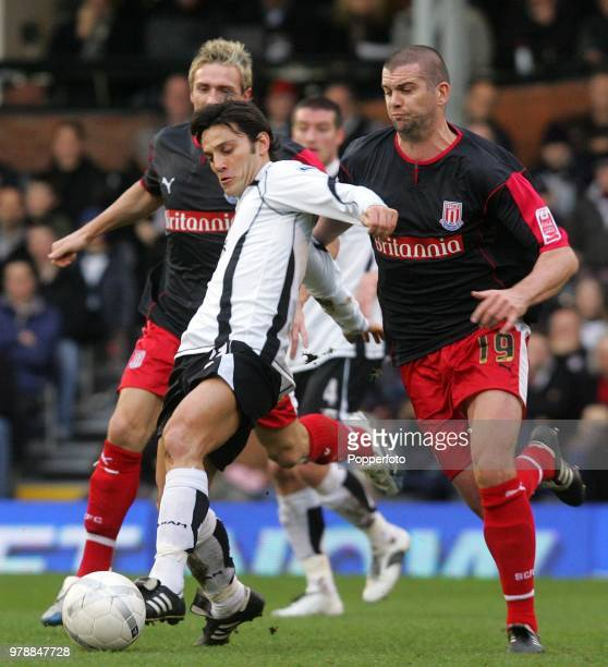 Vincenzo Montella of Fulham holds off Dominic Matteo of Stoke City during the FA Cup 4th round match between Fulham and Stoke City at Craven Cottage...