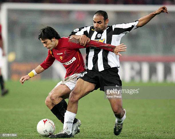 Vincenzo Montella of Roma is challenged by Ferreira Emerson of Juventus during the Serie A match between AS Roma and Juventus at the Stadio Olimpico...