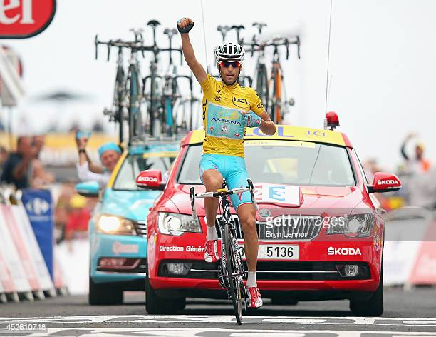 Vincenzo Nibali of Italy and Astana Pro Cycling celebrates winning the eighteenth stage of the 2014 Tour de France a 146km stage between Pau and...
