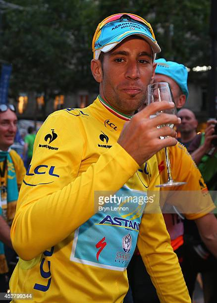 Vincenzo Nibali of Italy and Astana Pro Team celebrates victory with a glass of champagne following the twenty first stage of the 2014 Tour de...