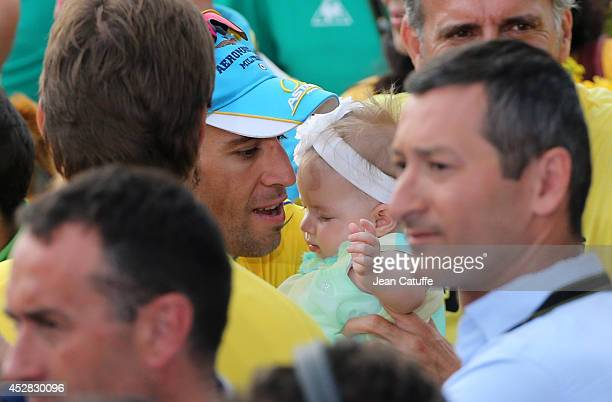 Vincenzo Nibali of Italy and Astana Pro Team holds his baby daughter Emma Nibali following the twenty first and last stage of the 2014 Tour de France...