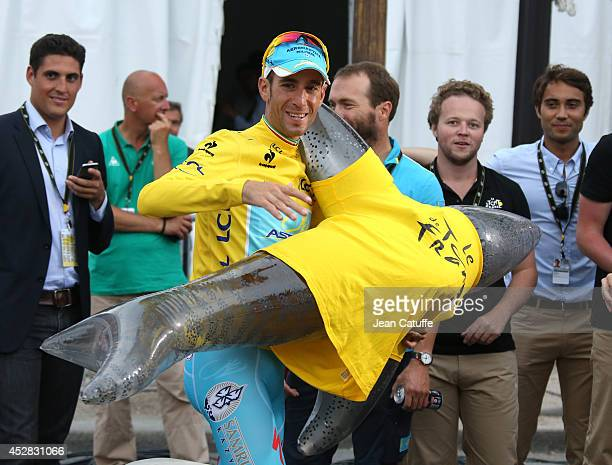 Vincenzo Nibali of Italy and Astana Pro Team poses with a squale, his nickname being 'the squall of Messine', following the twenty one and last stage...