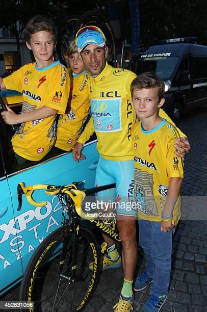 Vincenzo Nibali of Italy and Astana Pro Team poses with Alexander Vinokourov twins, Nicolas and Alexander Vinokourov, following the twenty one and...