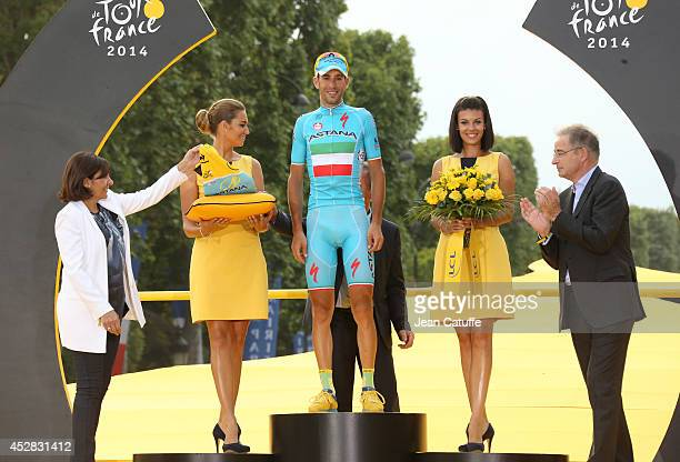 Vincenzo Nibali of Italy and Astana Pro Team receives the winning yellow jersey on the podium from mayor of Paris Anne Hidalgo , following the twenty...
