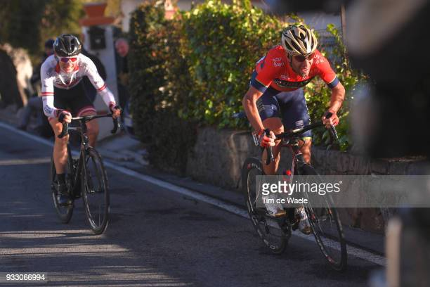 Vincenzo Nibali of Italy and Team BahrainMerida / Krists Neilands of Latvia and Team Cycling Academy / during the 109th MilanSanremo 2018 a 291km...