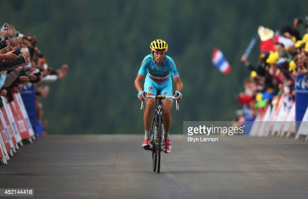 Vincenzo Nibali of Italy and the Astana Pro Team celebrates crossing the finish line to win the tenth stage of the 2014 Tour de France, a 162km stage...