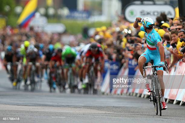Vincenzo Nibali of Italy and the Astana Pro Team celebrates winning the second stage of the 2014 Tour de France, a 201km stage between York and...