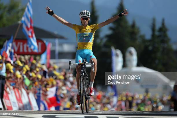 Vincenzo Nibali of Italy and the Astana Pro Team defends the overall race leader's yellow jersey and celebrates as he wins the thirteenth stage of...