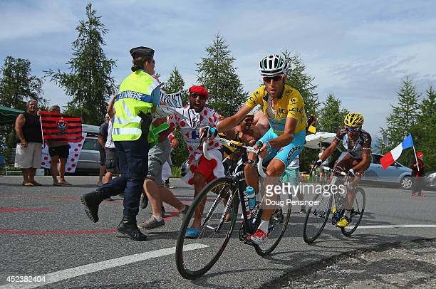Vincenzo Nibali of Italy and the Astana Pro Team defends the overall race leader's yellow jersey as he leads JeanChristophe Peraud of France and AG2R...