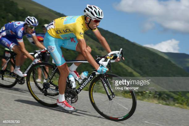 Vincenzo Nibali of Italy and the Astana Pro Team descends the Port de Bales as he defends the overall race leader's yellow jersey during the...