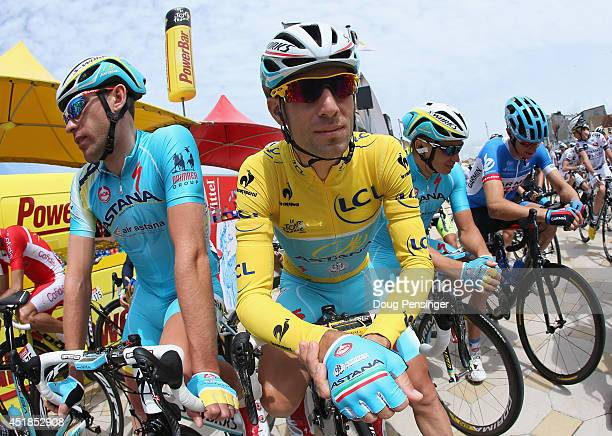 Vincenzo Nibali of Italy and the Astana Pro Team in the overall race leader's yellow jersey prepares for the start of stage four of the 2014 Le Tour...