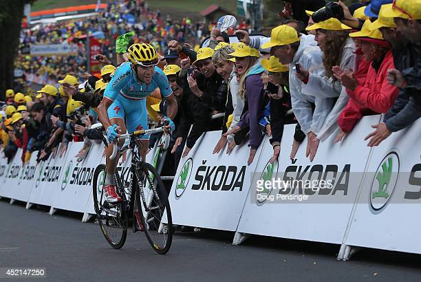Vincenzo Nibali of Italy and the Astana Pro Team makes the climb to the finish to win stage ten and recapture the overall race leader's yellow jersey...