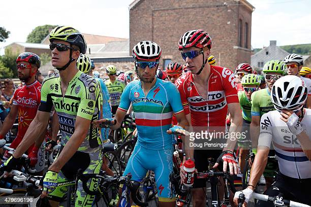 Vincenzo Nibali of Italy riding for Astana Pro Team tries to calm the peloton inculding Michael Rogers of Australia riding for Tinkoff-Saxo, Marcel...