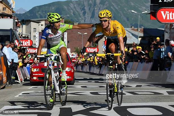 Vincenzo Nibali of Italy riding for Liquigas-Cannondale crosses the finish line with Bradley Wiggins of Great Britain riding for Sky Procycling in...