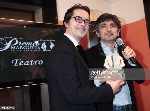Vincenzo Salemme receives his award from Fashion Producer Antonio Falanga during the '2009 Margutta Awards' at Margutta RistorArte on November 24...