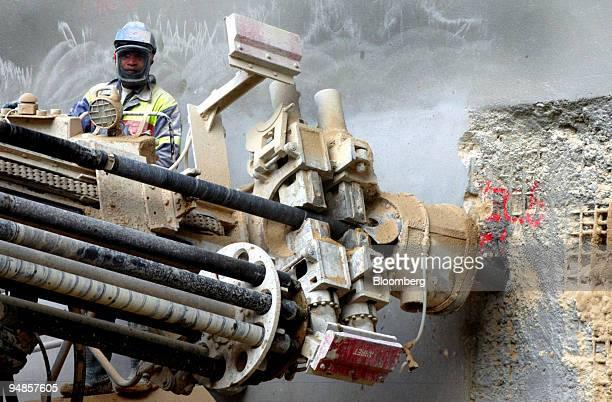 Vinci SA workman monitors a drilling machine at the La Tour construction site in the La Defense district of Paris France Tuesday July 5 2005