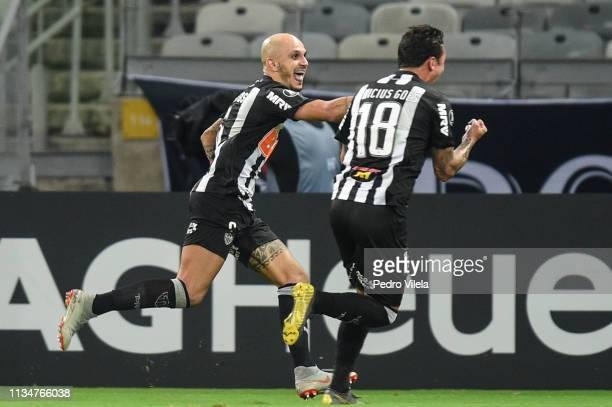 Vinícius and Fábio Santos of Atletico MG celebrate a scored goal against Zamora during a match between Atletico MG and Zamora as part of Copa...