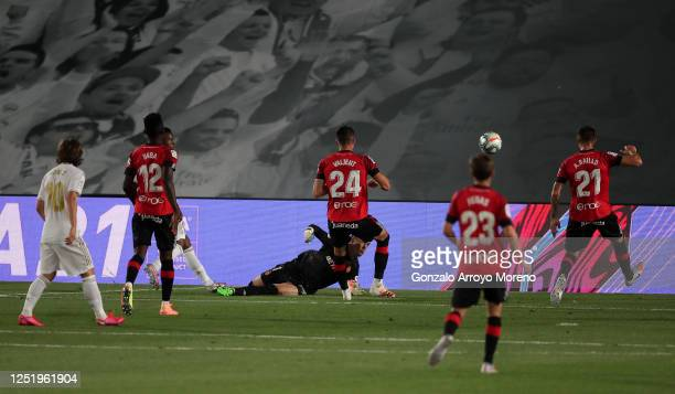 Vinícius Júnior of Real Madrid scores the opening goal during the Liga match between Real Madrid CF and RCD Mallorca at Estadio Alfredo Di Stefano on...