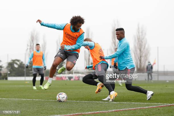 Vinícius Júnior tries to steal the ball from Marcelo and Martin Ødegaard during a training session at Valdebebas training ground on December 22, 2020...