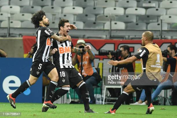 Vinícius of Atletico MG celebrates with teammate Luan after scoring his team's second goal during a match between Atletico MG and Zamora as part of...