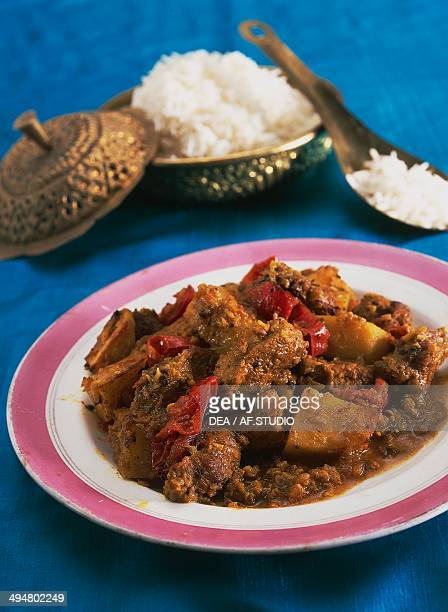 Vindaloo meat cooked with vinegar garlic chili and spices India