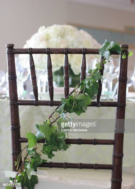 vine decoration back chair at wedding