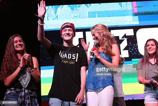 Vine star Crawford Collins and host Andrea Feczko take the stage at Fullscreens INTOUR at Pasadena Convention Center on September 13 2014 in Pasadena...