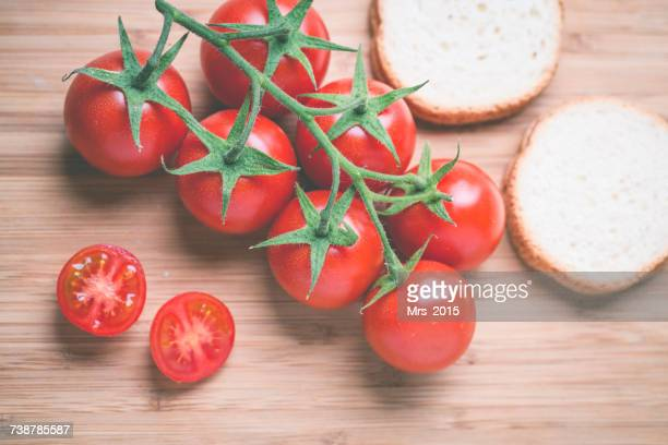 Vine tomatoes and cherry tomatoes with slices of white bread