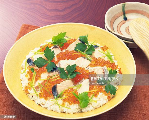 Vinegared rice with thin strips of egg, Pieces of raw fish, vegetables and crab meat arranged on top, High Angle View