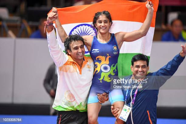 Vinesh Phogat of India celebrates after defeating Irie Yuki of Japan in the Women's Wrestling Freestyle 50kg Final on day two of the 2018 Asian Games...