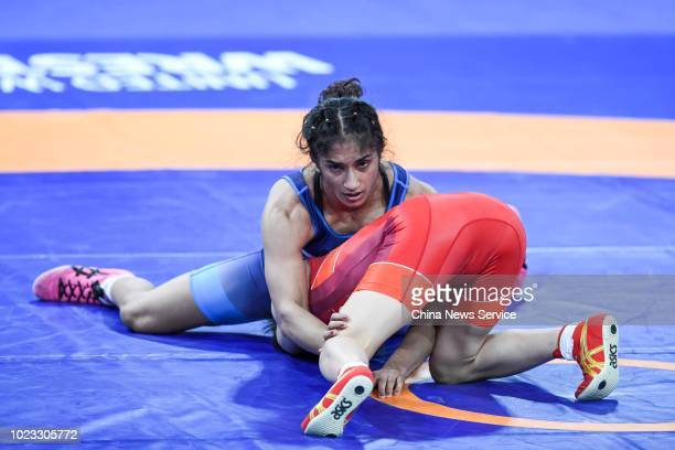 Vinesh Phogat of India competes against Irie Yuki of Japan in the Women's Wrestling Freestyle 50kg Final on day two of the 2018 Asian Games on August...