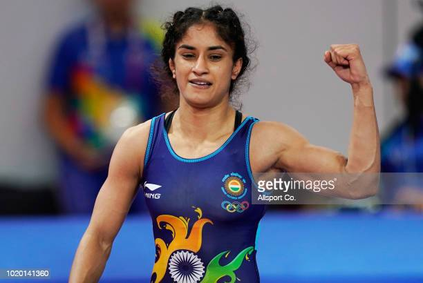 Vinesh Vinesh of India celebrates after she defeated Ire Yuki of Japan during the Women's Wrestling Free Style 50 kg gold medal match at the Gelora...