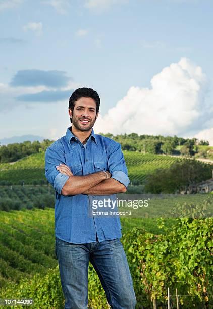 vineyard, landscape, farmer, crossed arms - stoppelbart stock-fotos und bilder
