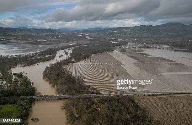 Vineyards and farmland along the Russian River are inundated by widespread flooding following days of torrential rain as viewed on January 11 near...