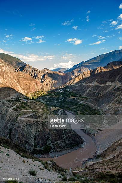 Vineyards and villages cling to the steep slopes of the Mekong River valley here also known as the Mekong Grand Canyon in northern Yunnan Partly...