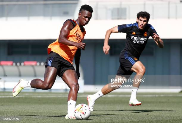 Vini Jr. And Jesús Vallejo both of Real Madrid are training at Valdebebas training ground on August 17, 2021 in Madrid, Spain.