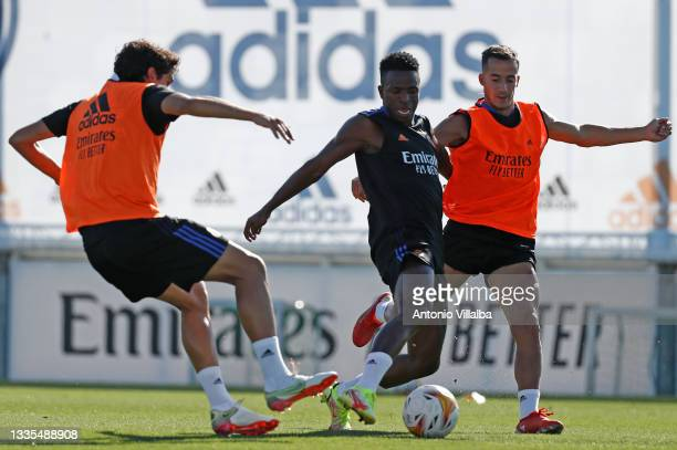 Vini Jr. And Lucas Vázquez both of Real Madrid are training with teammate Jesús Vallejo at Valdebebas training ground on August 21, 2021 in Madrid,...