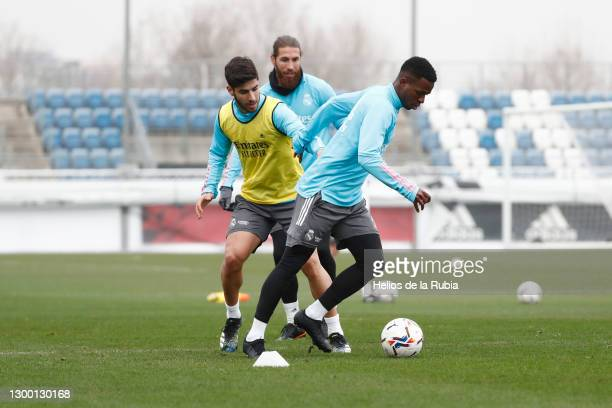 Vini Jr., Marco Asensio and Sergio Ramos of Real Madrid in action during a training session at Valdebebas training ground on February 03, 2021 in...