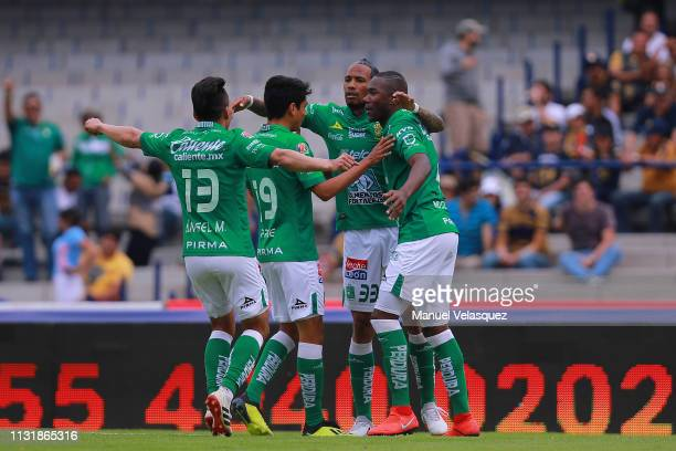 Vinicio Angulo of Leon celebrates with teammates after scoring the third goal of his team during the 8th round match between Pumas UNAM and Leon as...