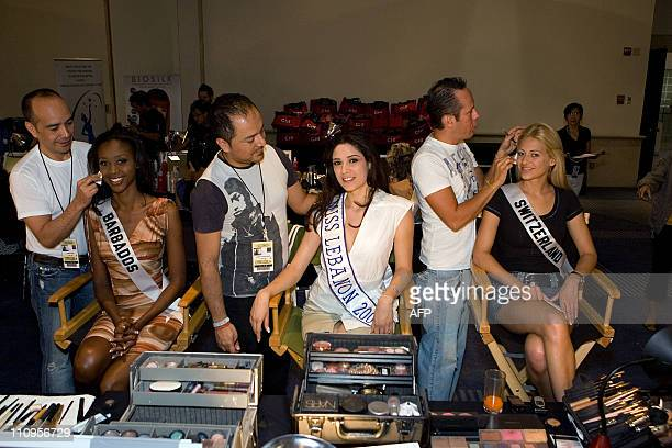 Vinicio Conti Lazaro Gonzalez and Alfonso Waithsman do the makeup of Jewel Garner Miss Barbados 2007 Nadine Njeim Miss Lebanon 2007 and Christa...