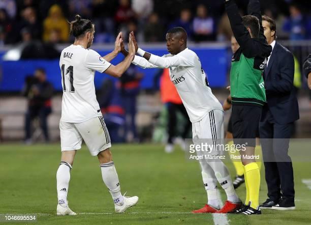 Viniciu Jr of Real Madrid substitutes Gareth Bale during the La Liga match between Deportivo Alaves and Real Madrid at Estadio de Mendizorroza on...