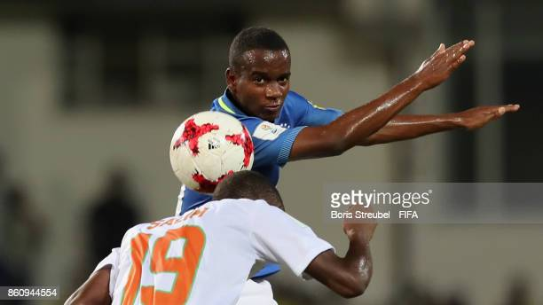 Vinicius Jr of Brazil jumps for a header with Salim Abdourahmane of Niger during the FIFA U17 World Cup India 2017 group C match between Niger and...